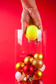 Christmas vase wearing a cristmas tenis boll hand — Stock Photo