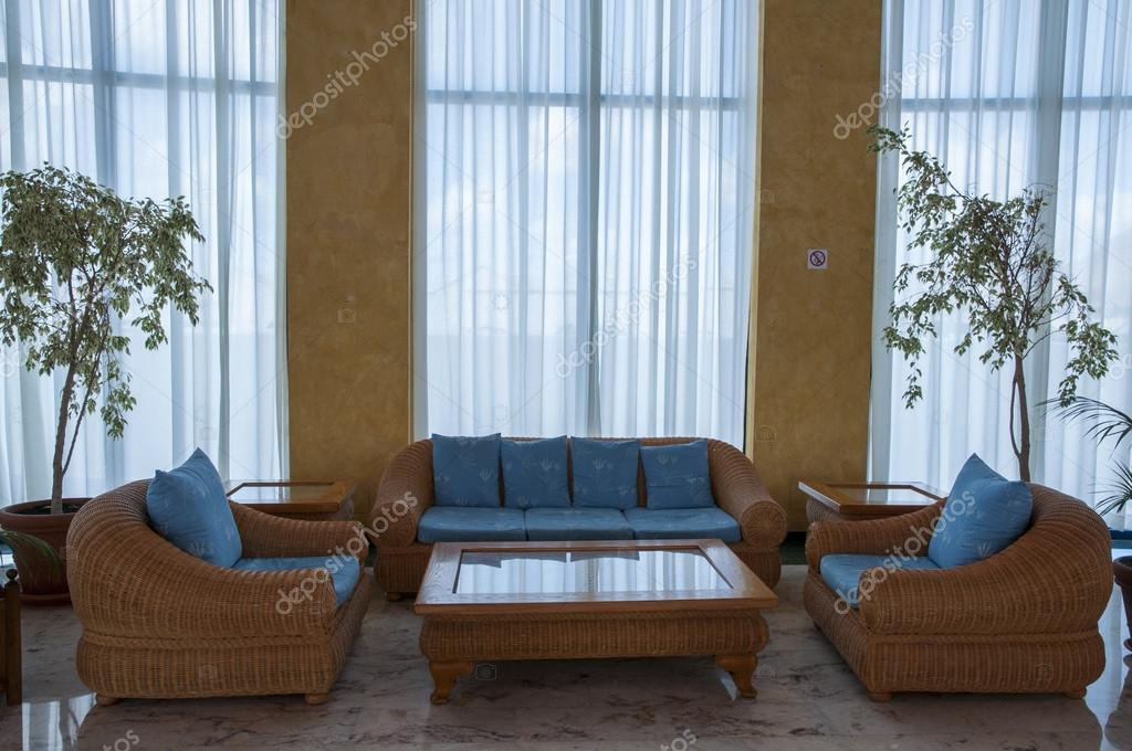 Lounge with tables and sofas and decorations — Stock Photo #16352691