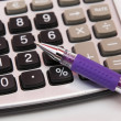 Stock Photo: Calculator with pen