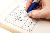 Hand making a sudoku — Stock Photo
