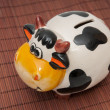 Cow piggy bank — Stock Photo #33176007
