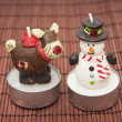 Foto Stock: Candles snowmen