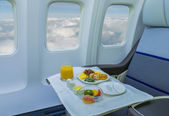 Lunch on board of airplane — Stock Photo