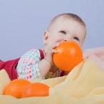 Baby with oranges — Stock Photo #12315473