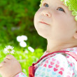 Baby-girl with flower — Stock Photo