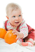 Baby with oranges — Stock Photo