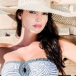 Beautiful girl with hat at the beach — Stock Photo #12346090