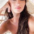 Beautiful girl with hat at the beach — Stock Photo #12346092