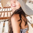 Beautiful girl with hat laughing — Stock Photo #12346094
