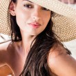 Beautiful girl with hat at the beach — Stock Photo