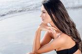Beautiful girl looking at the sea waiting — Stock Photo
