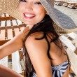 Beautiful girl with hat laughing — Stock Photo #12726679