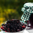 Stock Photo: Fresh blackberries and jar of jam