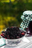 Fresh blackberries and a jar of jam — Stock Photo
