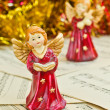 Christmas figurine of angels on a music sheet — Stock Photo