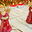 Royalty-Free Stock Photo: Christmas figurine of angels on a music sheet