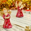 Stock Photo: Christmas figurine of angels on music sheet