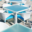 Stock Photo: Rows of empty tables and chairs in open air cafe bar