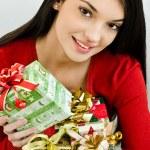 Girl holding Christmas presents — Stock Photo #15039133