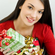 Girl holding Christmas presents — Stock Photo #15039143