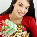 Girl holding Christmas presents — Stock Photo #15039143
