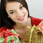 Girl holding Christmas presents — Stock Photo #15039163