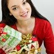 Girl holding Christmas presents — Stock Photo