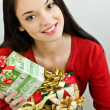 Girl holding Christmas presents — Stock Photo #15039167