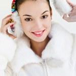 Beautiful girl wearing ear muffs — Stock Photo #15039253