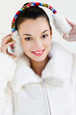 Beautiful girl wearing ear muffs — Stock Photo