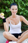 Girl holding a yellow apple — Stock Photo