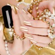 Stock Photo: Gold manicure