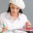 Beautiful student girl wearing a beret. — Stock Photo