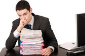 Worried business man with a lot of work. — Stock Photo