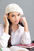 Beautiful student girl wearing a beret. — Stock Photo
