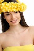 Portrait of a sexy woman with wreath of yellow flowers. — Stock Photo