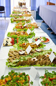 Catering table full of appetizing foods. — Stock Photo