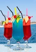 Summer red and blue fruit cocktail. — Stock Photo