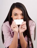 Beautiful girl holding a visit card. — Stock Photo