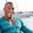 Summer marine scene with a handsome black man.  — Stock Photo