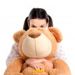 Girl hiding behind the big teddybear. — Stock Photo