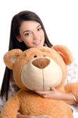 Mooi meisje met een grote teddybeer. — Stockfoto