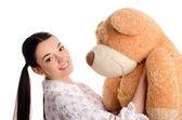 Beautiful girl with a big teddy bear. — Stock Photo