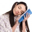 Tired woman falling asleep reading. — Stock Photo