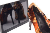 High heels and tablet. — Stock Photo