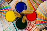 Paint samples and cans. — Stock Photo