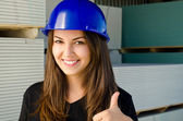 Beautiful girl wearing a blue safety helmet, — Stock Photo