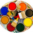 Stock Photo: Different color cans of paint and brushes on swatches background.