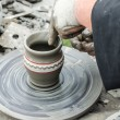 Close-up of hands making pottery from clay on a wheel. — Stock Photo