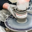 Close-up of hands making pottery from clay on a wheel. — Stock Photo #32877757
